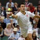 Novak Djokovic hits a return to Jo-Wilfried Tsonga. REUTERS/Toby Melville