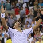 Novak Djokovic of Serbia celebrates after defeating Rafael Nadal of Spain in the men's final of...