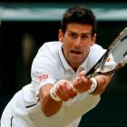 Novak Djokovic of Serbia hits a return to Jeremy Chardy of France in their men's singles match at...