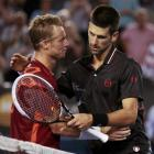 Novak Djokovic (R) of Serbia embraces Lleyton Hewitt of Australia after their match at the...
