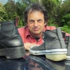 Oamaru man John Baster compares the boots altered by McKinlays Footwear of Dunedin (left) to the...