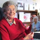 Oamaru's Bina Mulligan, who turns 100 tomorrow, with her birthday card from the Queen, and others...