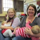 Angela Henderson and Ruby Henderson (9 months), of Weston, left, and Sonia Hudson and Rosie...