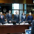 Observing a minute of silence during a European Union extraordinary summit seeking for a solution...
