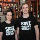 Octagon bar Ratbags staff Laura Dowling (22) and Jared Hewitt (20) wear ''Save Dunedin's...