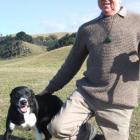 Des Lysaght and Tyke take a break from competing at the Oamaru Collie Club's trials yesterday....