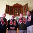Long-serving members of IOOF Waiareka Lodge No 51 gather below the lodge's honours board at the...