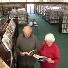 Bernard and Anna Wilkinson check out new books at newly reopened Oamaru Library. Photo by David...