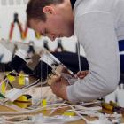 Oliver Forsyth, of  Electrical Training Co Ltd, in Dunedin, works on a switching unit as part of...