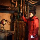 Olveston visitor Cynthia Greensill admires the house's normally hidden original boilers.