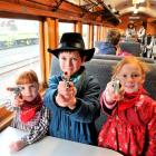 On board the train before departure are (from left) Anna Telfer Chiles (5), Josh Telfer Chiles (8...