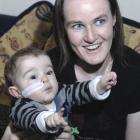 Only a feeding tube gives away the fact the health of Dunedin toddler Reuben Jones (1), with his...