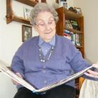 Ono Forbes, of Gore, looks back over a scrapbook containing memories of 75 years of letter...