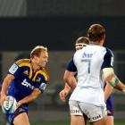 Tony Brown looks for support with a blank scoreboard in the background during the Highlanders...