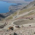 A reservoir and trenches for pipes have been excavated on Ohau Snowfields (with Lake Ohau in the...