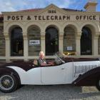 Ophir postmistress Val Butcher sits in the lap of luxury, a 1934 Bugatti Gangloff Roadster ''Type...