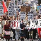 Opponents of state asset sales march down George St on Saturday before a rally in the Octagon....