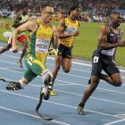 Oscar Pistorius of South Africa (L) runs next to Greg Nixon of the US (R) and Jermaine Gonzales...