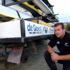 Club captain Donald Taylor waits for the tyres on a trailer to be replaced at the Oamaru Rowing...
