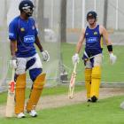 Otago all-rounder Dimitri Mascarenhas (left) and opener Aaron Redmond spend time in the nets...