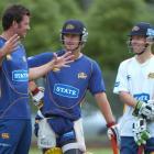 Otago all-rounder Ian Butler entertains his team-mates Neil Broom (left) and Derek de Boorder...