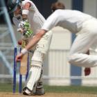 Otago bowler James McMillan skittles Central Districts batsman Tim Weston at Napier yesterday....