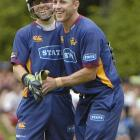 Otago captain Craig Cumming (right) celebrates with wicketkeeper Derek de Boorder after the pair...