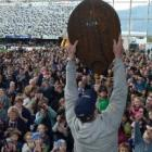 Otago captain Paul Grant raises the Ranfurly Shield to the delight of thousands of fans at...