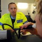 Otago Daily Times reporter Lea Jones takes part in a mock breath test for Constable Patrick...