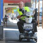 Otago Daily Times reporter Shawn McAvinue gives a mobility scooter a whirl in South Dunedin...