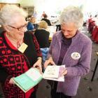 Otago Embroiderers Guild president Margaret Kennedy (left) and tutor Eunice McLeod examine...