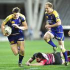 Otago fullback Glenn Dickson (left) goes on the charge against Canterbury at Forsyth Barr Stadium...