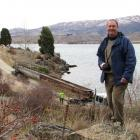 Otago Goldfields Heritage Trust president Martin Anderson watches over the relocation of the Gold...