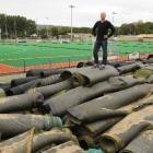 Otago Hockey chief executive Chris Aubin stands on top of the remnants of the old sand-based turf...