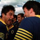 Otago loose forward Taine Randell yells with delight at team-mate John Leslie after the 1998...