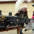 Otago Model Engineering Society life member Des Burrow (84) prepares his model steam engine for a...