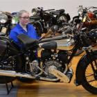 Otago Museum content services officer Rebecca Keenan examines a 1936 Brough Superior SS80 De Luxe...