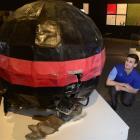 Otago Museum design services co-ordinator Craig Scott examines the earthquake-damaged Lyttelton...