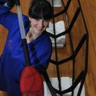 Otago Museum design services co-ordinator Rebecca McMaster takes a closer look at a glass paddle...
