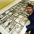 Otago Museum humanities collection co-ordinator Scott Reeves looks at a large sculptural mural by...