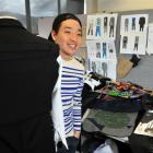 Otago Polytechnic fashion student Marc Jun works on his menswear collection, which he hopes to...