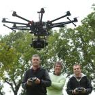 Otago Polytechnic student Aaron McGrouther (left) flies Animation Research Ltd's new drone at...