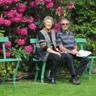 Otago rugby great Tuppy Diack (83) sits with wife Margaret (84) on salvaged Rose Stand seats....
