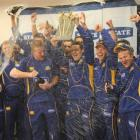 Otago's cricketers celebrate winning the twenty/20 title at University Oval yesterday. Photo by...