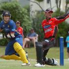 Otago's Nathan McCullum works the ball past Canterbury wicketkeeper Kruger van Wyk on his way to...