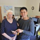 Otago Seafarers Centre manager Shirley Farquhar, QSM, (80) with cruise-ship waiter Eduardo Gan ...