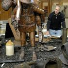 """Otago Settlers Museum Curator Sean Brosnahan admires a copper sculpture """"Cobbers"""" by Rik Ryon of..."""
