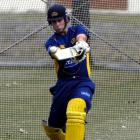 Otago top order batsman Shaun Haig gets in some slogging practice ahead of the twenty/20 match to...