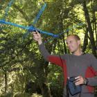 Otago University masters student Robert Schadewinkel tracks robins in the Orokonui Ecosanctuary...