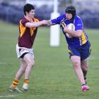 Otago Whalers forward Shane Unahi puts the fend on Southland Rams winger Zac Archer during the...
